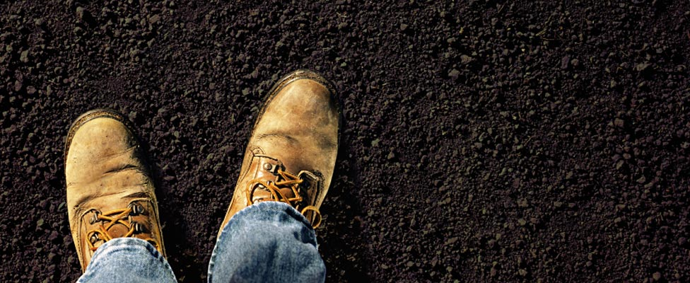 Feet firmly on the ground of new topsoil